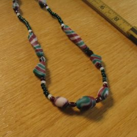 Christmas Stripe necklace: polymer clay, garnet, and glass beads