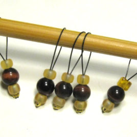 Beaded stitch markers: Red tiger-eye and gold glass