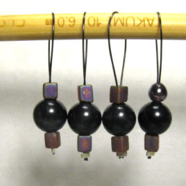 Beaded stitch markers: Blue tiger-eye and purple glass