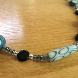 Teal Circles series #1: glow-in-the-dark polymer clay & glass beaded necklace