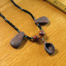Rust and Turquoise: Calla Lily 2 polymer clay and glass beaded necklace